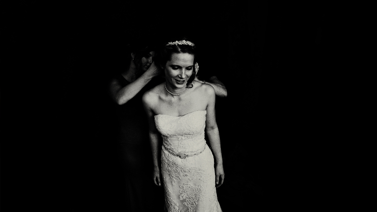 Black and white portrait of a bride getting ready at Singleton Lodge in Lancashire