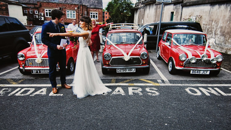 lancashire wedding photographers with mini coopers and bride and groom