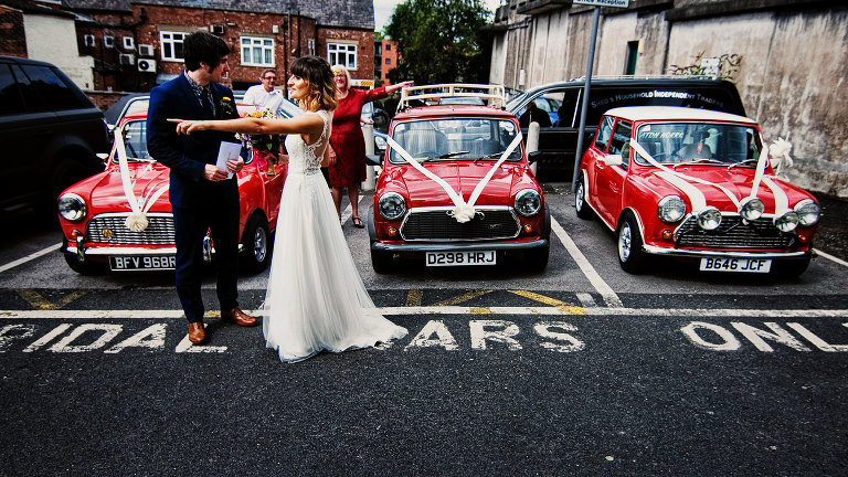 Red mini coopers in stockport town hall wedding