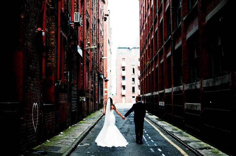 Creative wedding portrait of a bride and groom in the northern quarter Manchester