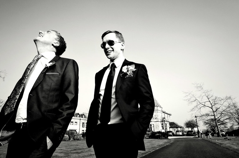 Groom and best outside Rookery Hall in Cheshire