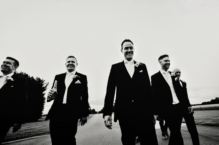Groom and groomsmen with ushers