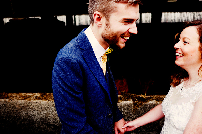 Bride and groom on a farm wedding in cumbria