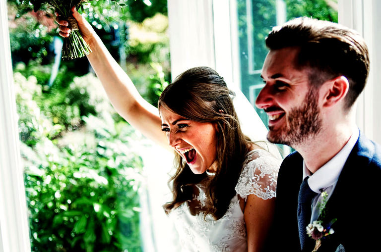 bride and groom celebrating at Didsbury House Hotel