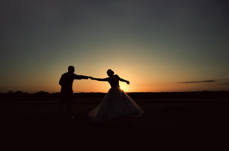 beautiful sunset photograph with bride and groom at Beeston manor in lancashire
